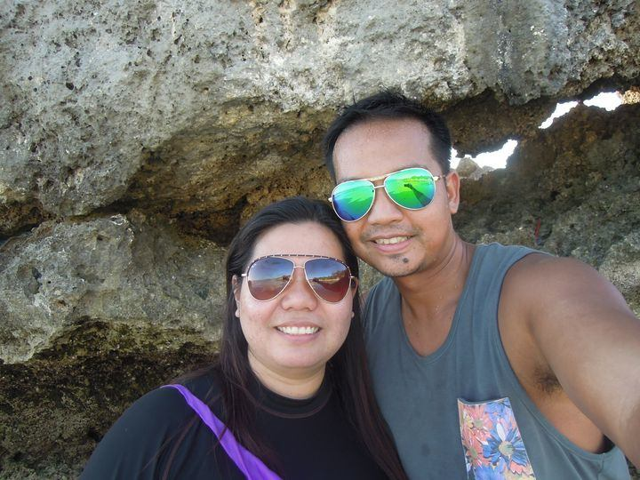 Photo of a couple travel blogger at Willy's Rock in Boracay