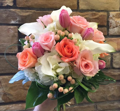 Peach, pink and white prom and wedding clutch bouquet by Stein Your Florist Co.