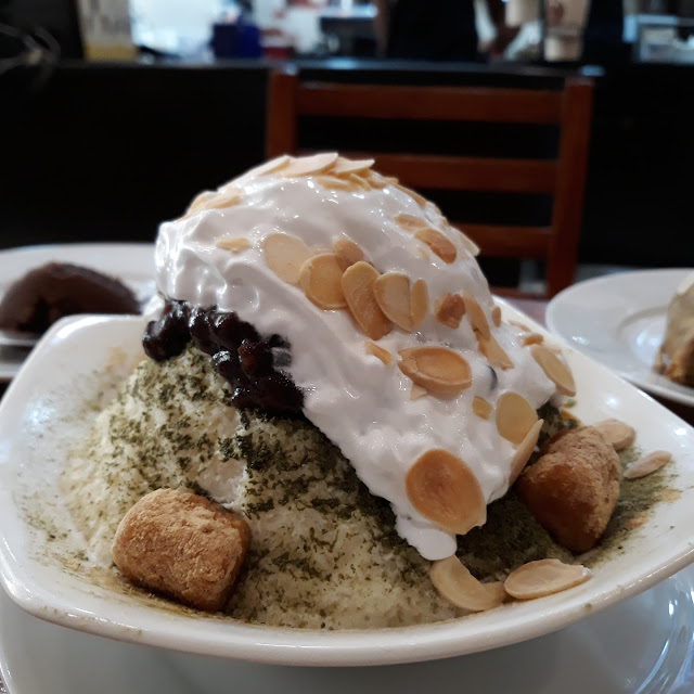 Green tea bingsu-  This bingsu has on top green tea powder, injeolme,  almond slivers, whipped cream, red bean (also in mid-ice), with the uniquely Korean fine ice.