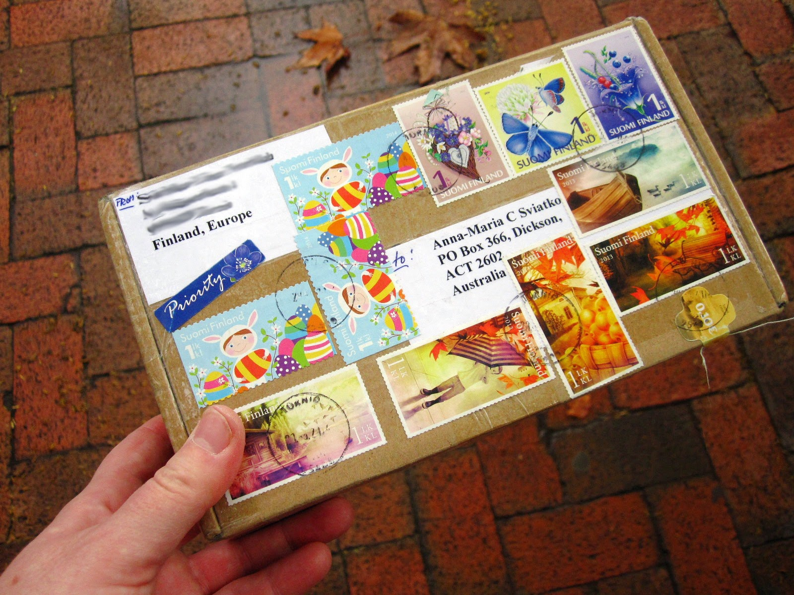 Small package from Finland, covered in colourful postage stamps