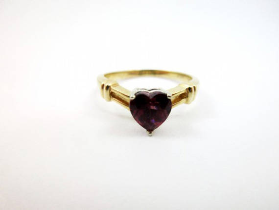 https://www.etsy.com/listing/536837662/vintage-garnet-ring-28g-14k-yellow-gold?ref=listings_manager_grid