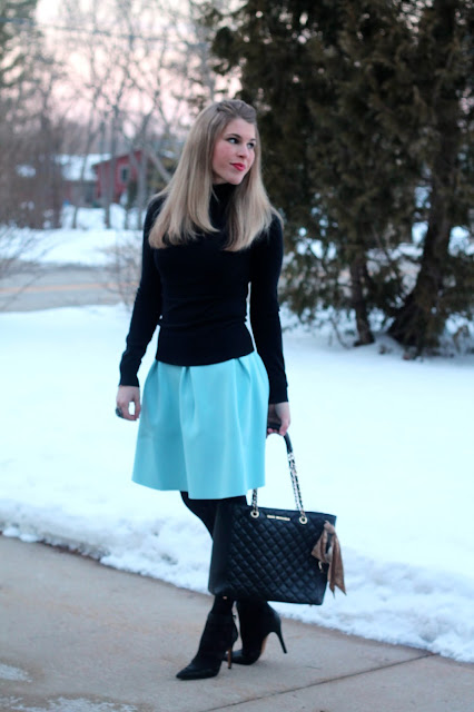black turtleneck, light blue skirt, black tights, black heels, black leather quilted tote
