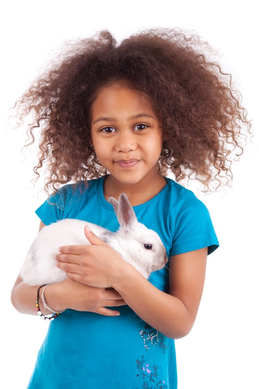A happy young girl with her pet rabbit