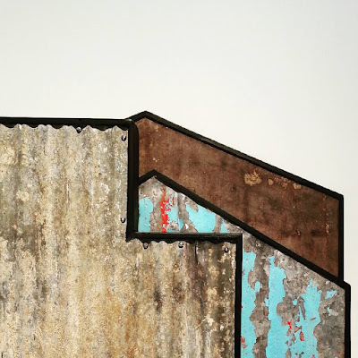 Detail of an assemblage art piece by Alex Asch, made up of various pieces of distressed corrugated iron.