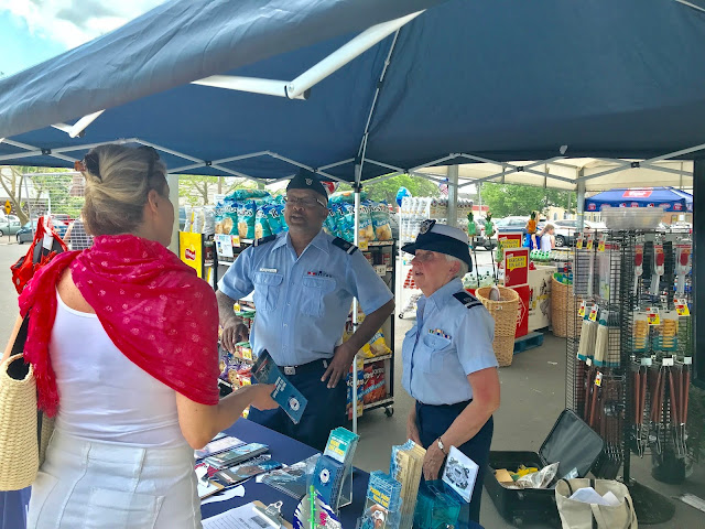 Auxiliarists David Witherspoon (left) and Alyce Schroth (right) answered a question about the role of the US Coast Guard Auxiliary in the community.
