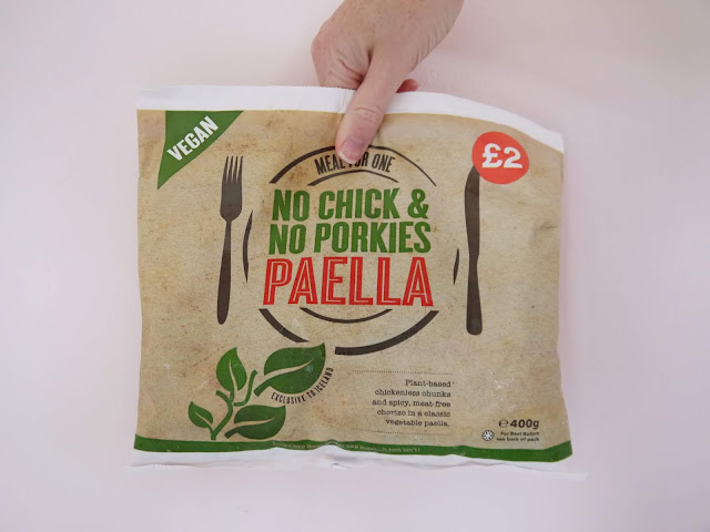 a beige bag with 'no chick no porkies paella' written on a plate in green text