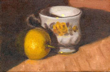 Oil painting of a lemon (retaining part of its stalk) alongside a white Queen Anne teacup decorated with a yellow rose.