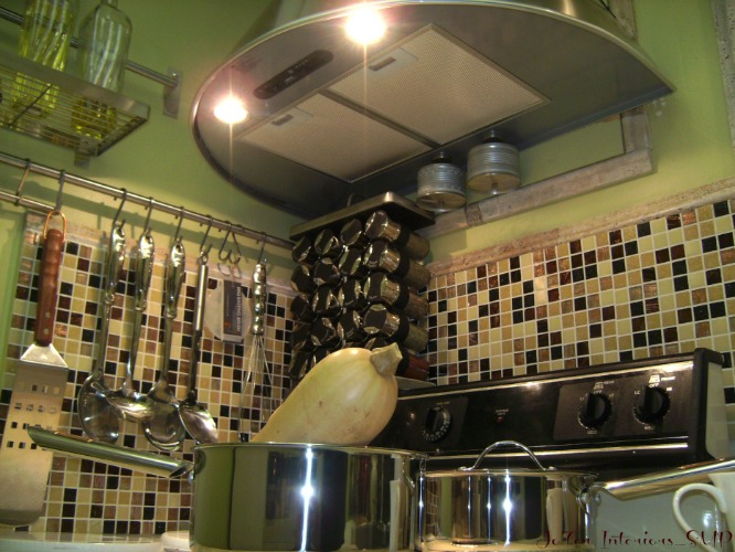 A Small Apartment Kitchen Redone with spot lighting, glass tiles, Hood Range and extendable head kitchen faucets