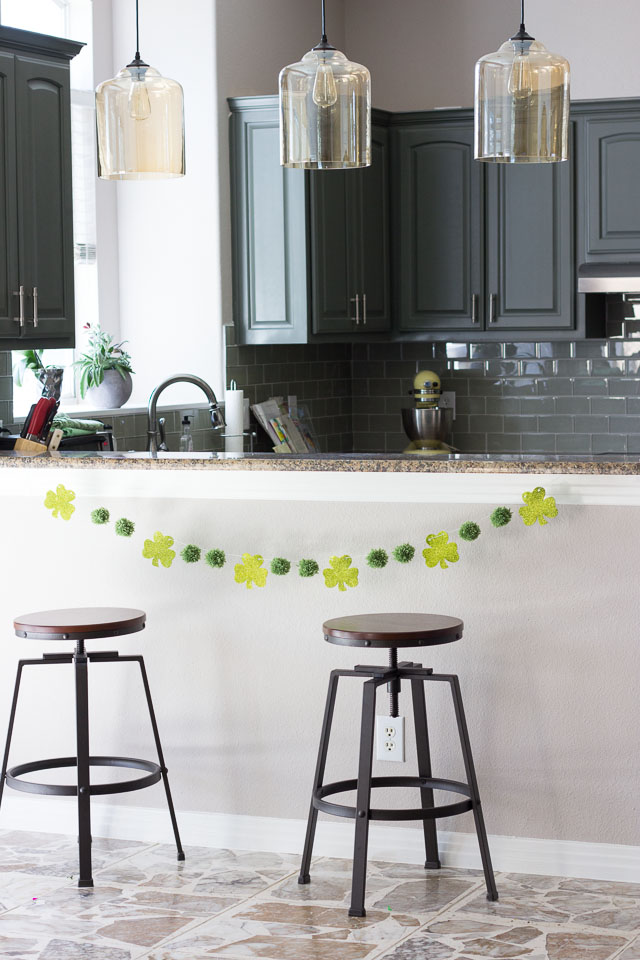 Pom-poms and shamrocks make the perfect stylish St. Patrick's day garland!