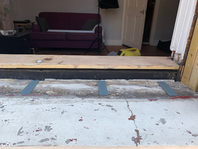 leveling the base for a sash window