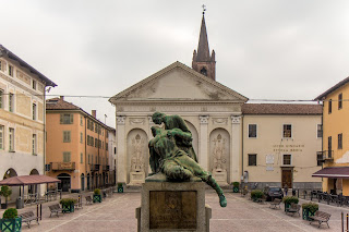 Piazza Sant'Agostino in Carmagnola. The town's war memorial is in the foreground