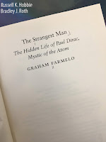The Strangest Man: The Hidden Life of Paul Dirac, Mystic of the Atom, by Graham Farmelo, superimposed on Intermediate Physics for Medicine and Biology.