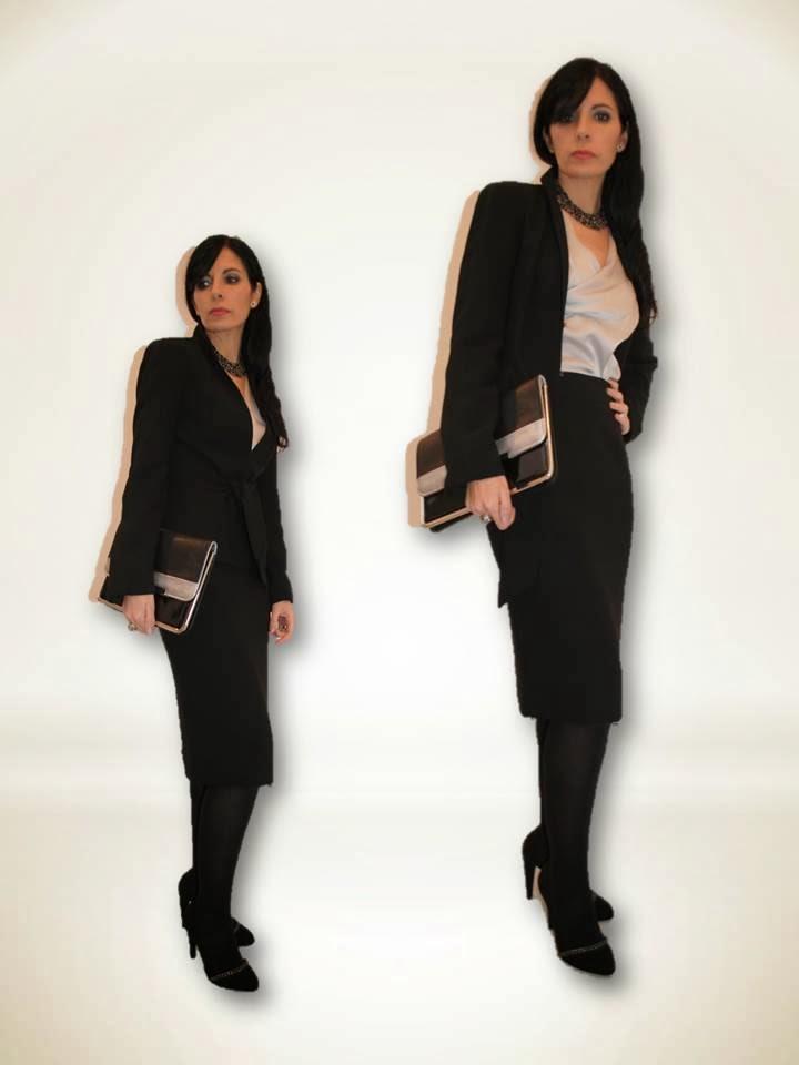 6356fd78af En las fotos llevo un traje negro de dos piezas
