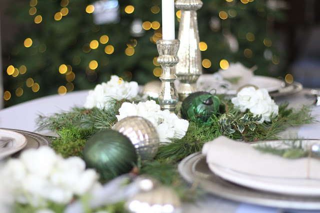 holiday tablescape ornaments greens mercury candleholders