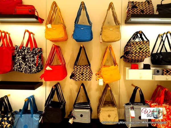A colorful array of Kipling women's handbags, tote bags and sling bags