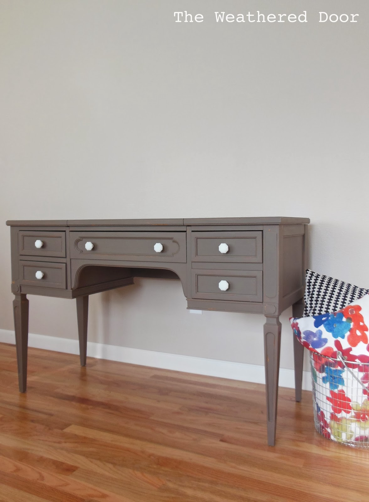 A taupe writing desk with milk glass knobs The Weathered