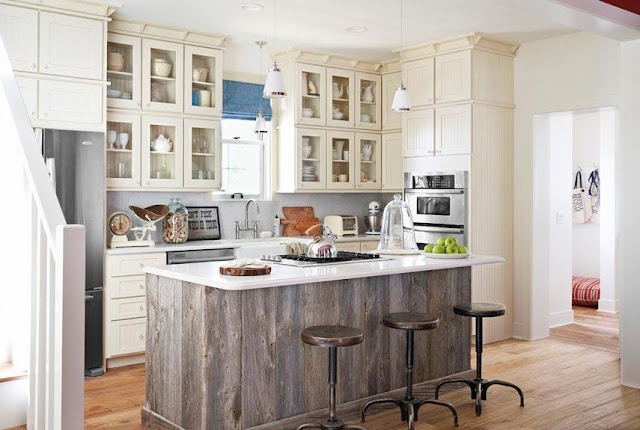 repurposed kitchen island ideas with overhang for antique bar stools, stove and white granite countertops ideas pictures. open small kitchen design with glass doors off white cabinets to ceiling, stainless steel appliances, white granite countertops, sink and dishwasher ideas
