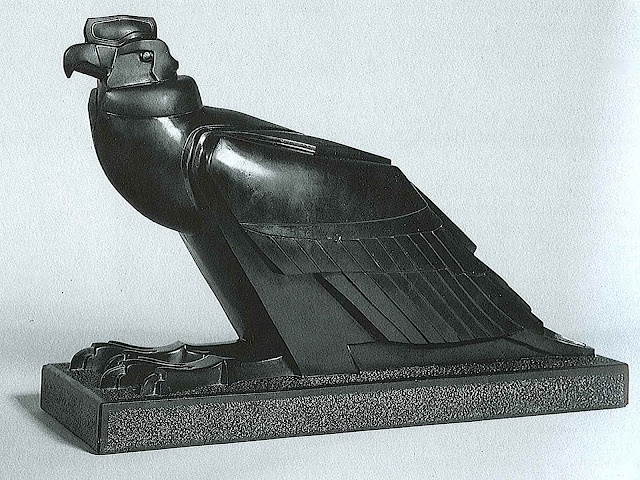 a color photograph of 1920s-30s art deco sculpture, a black eagle or Maltese Falcon