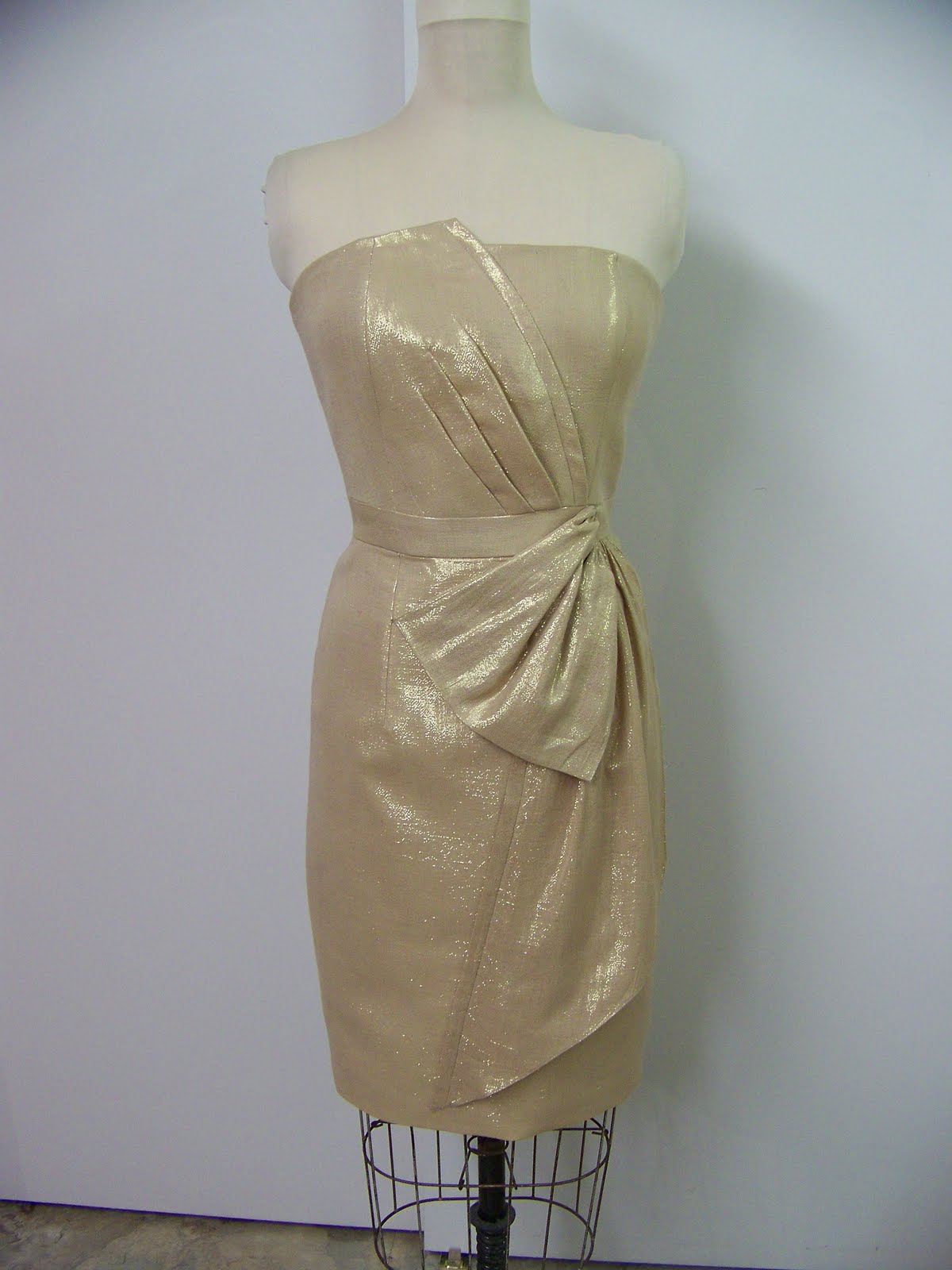 76e521214c This gold dress just got to be my newest favorite. Love the top, the  asymmetric front, the folds and pleats, and even the bow at the waist.