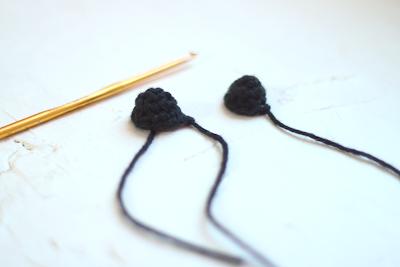 small black crocheted feet