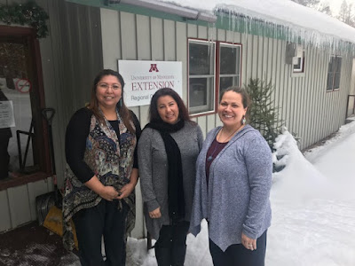 Tawny Smith-Savage, Brianna Michels and Susan Beaulieu standing outside of a building in the snow