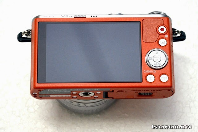 The rather large touch-screen LCD, with the familiar Panasonic Lumix styled buttons and dials