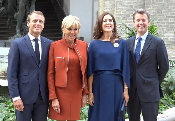 Brigitte Macron wore a dress by Louis Vuitton. Crown Princess Mary wore Stella McCartney cape gown. President Emmanuel Macron
