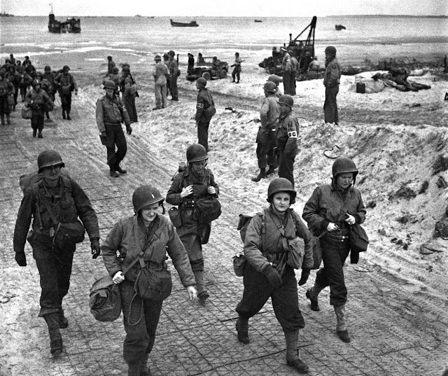 American nurses land on the Normandy beach in July 1944