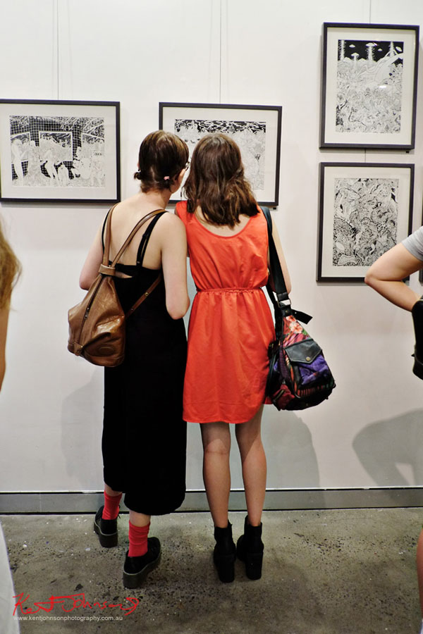 Two young women, black dress red dress, contrasting socks an bags. GORO at m2 gallery. Photographed by Kent Johnson for Street Fashion Sydney.