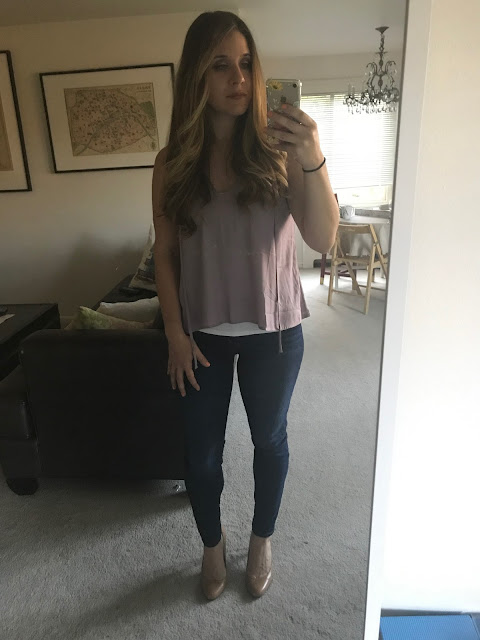 Clothing on girl in front of mirror. Lush Top, Joe's Jeans and Nine West Pumps.