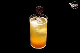cocteles con tequila y cerveza la malquerida barman in red