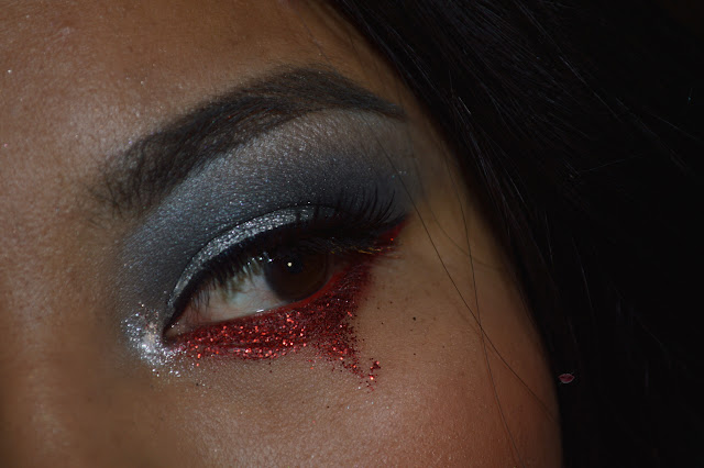 Eye makeup with red glitter and red eyeliner 079 by Inglot
