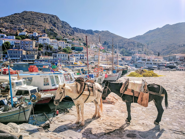 Horses, boats and buildings of Hydra, Greece