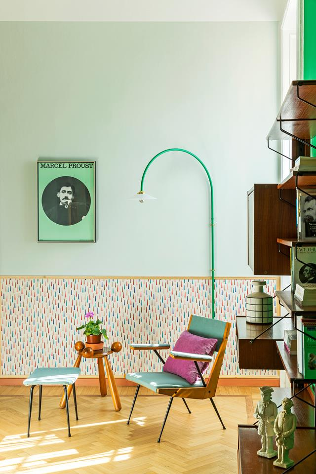"A reading corner features Maharam ""Showers"" wallpaper by Alexander Girard, a '50s bookcase and armchair, and wall lamp by Muller van Severen - design addict mom"