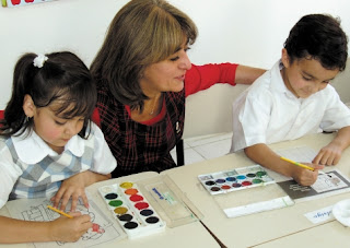 NAMC encouraging quiet in the montessori environment teacher with painting students