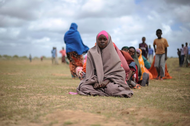 Women waiting for food aid at a distribution  center in the city of Afgoye, Somalia.