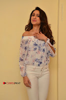 Actress Pragya Jaiswal Latest Pos in White Denim Jeans at Nakshatram Movie Teaser Launch  0059.JPG