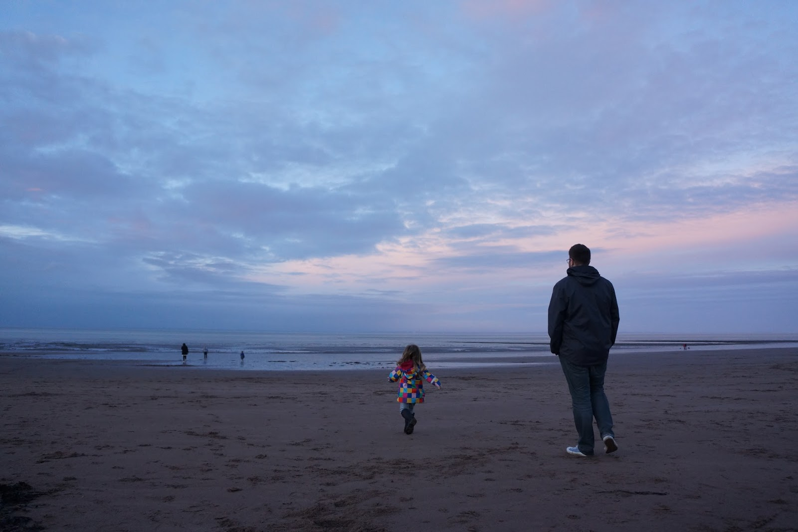 dad and daughter on a beach at butlins minehead
