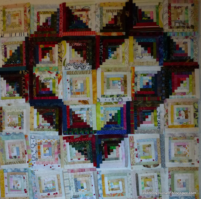 Half-inch logs in dark and light form a heart on this quilt.