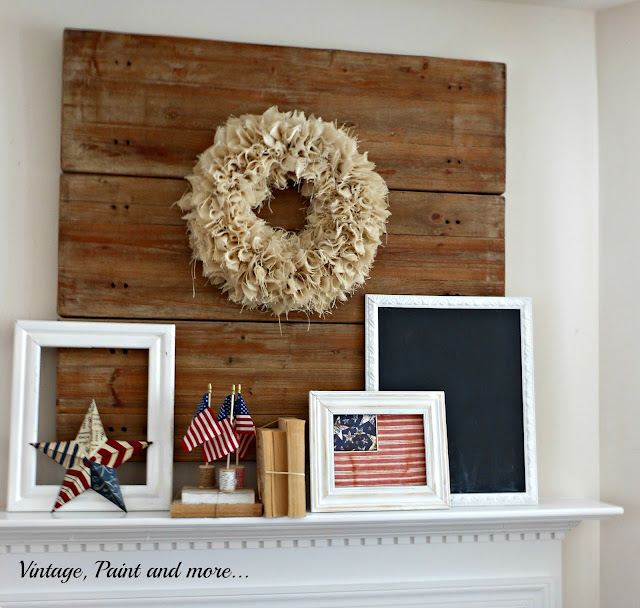 Vintage, Paint and more... a vintage mantel featuring a rustic wood back drop with a burlap wreath, distressed frames and flags
