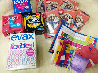 Contenido de la caja, con los paquetes para probar y kits para repartir