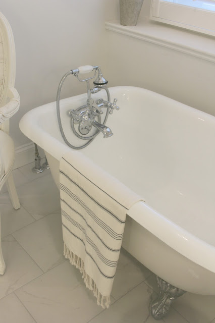 Vintage cast iron clawfoot tub with Turkish towel by Hello Lovely Studio
