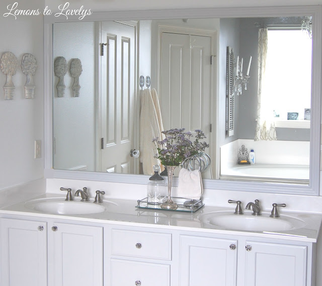 Bathroom Cabinet Makeover & DIY Mirror Frame- Paint color, Stonington Gray by BM - See more pictures on lemonstolovelys.blogspot.com