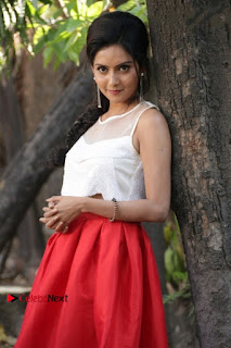 Actress Mahima Nambiar Latest Stills in White Top and Red Skirt at Kuttram 23 Movie Press Meet  0018.jpg