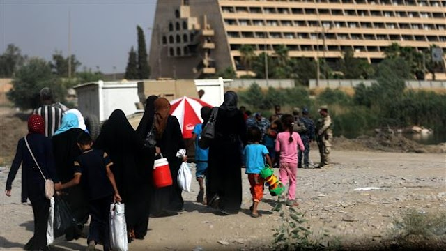 Mosul residents returning in search of loved ones under debris
