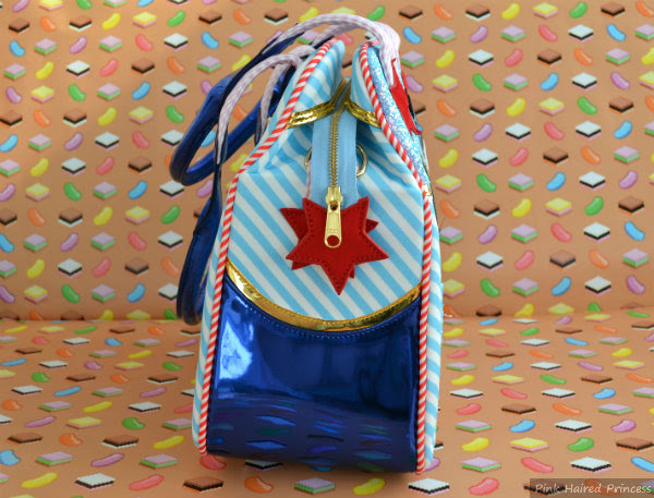 irregular choice disney donald duck bag side view with star zip detail