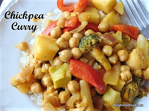 Chickpea Curry with Vegetables and Coconut Milk served on bed of hot rice.
