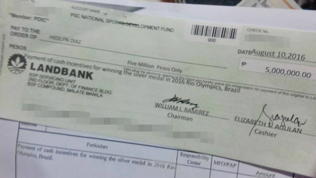 LOOK: P5 million check of Olympian silver medalist Hidilyn Diaz
