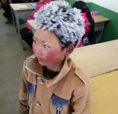 Boy's hair freezes during walk to school in below freezing temperatures