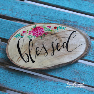 http://www.doodlecraftblog.com/2016/08/faux-calligraphy-on-wood-slice.html